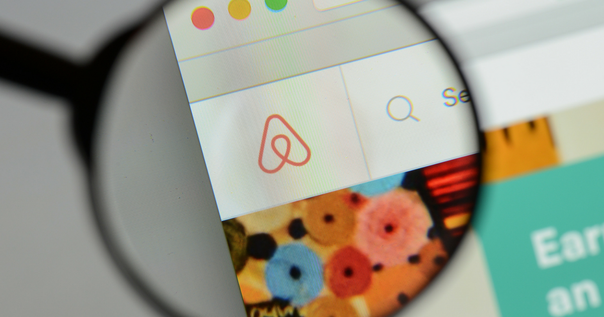 Airbnb logo under glass.